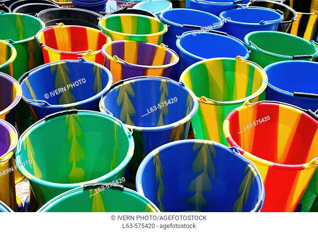 Multi-coloured buckets at market, Loropeni. Burkina Faso