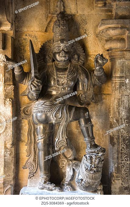 Koshtha image of dvarapala in the Subrahmanya shrine. Brihadishvara Temple, Thanjavur, Tamil Nadu, India