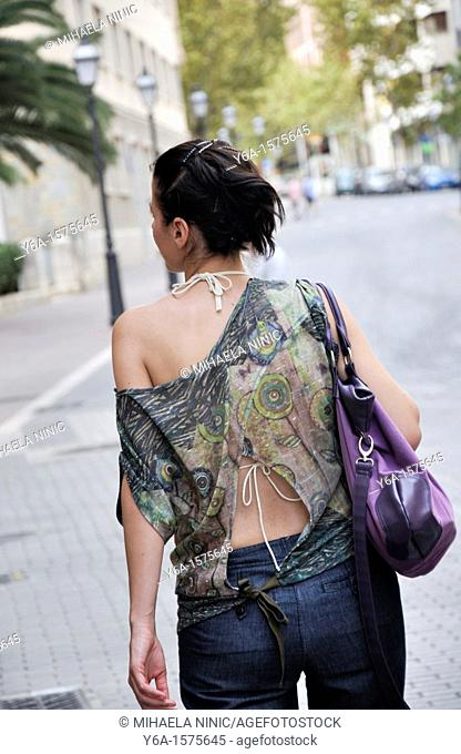 Rear view of a woman on the street of Palma De Mallorca, Spain, Europe