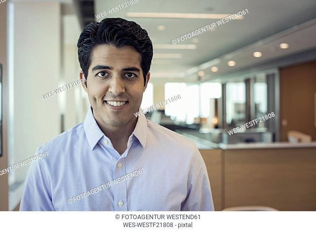 Indian man in office, portrait