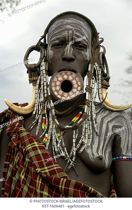 Africa, Ethiopia, Debub Omo Zone, woman of the Mursi tribe  A nomadic cattle herder ethnic group located in Southern Ethiopia