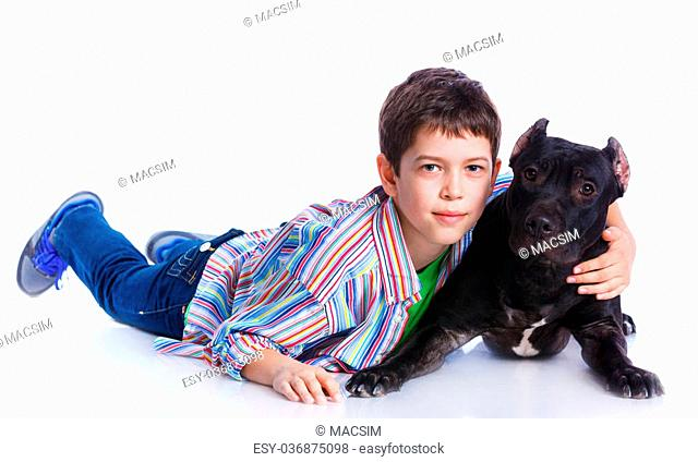 9c076bcdd076 Cute boy with his Pit Bull Terrier smiling at camera on isolated white  background