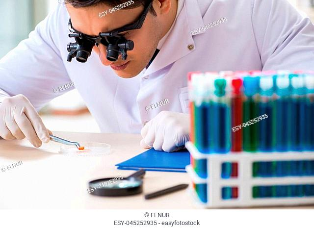 Drug synthesis concept with chemist working in research lab