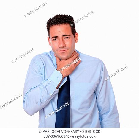 Portrait of a handsome young man on blue shirt and tie with throat pain looking at you on isolated studio