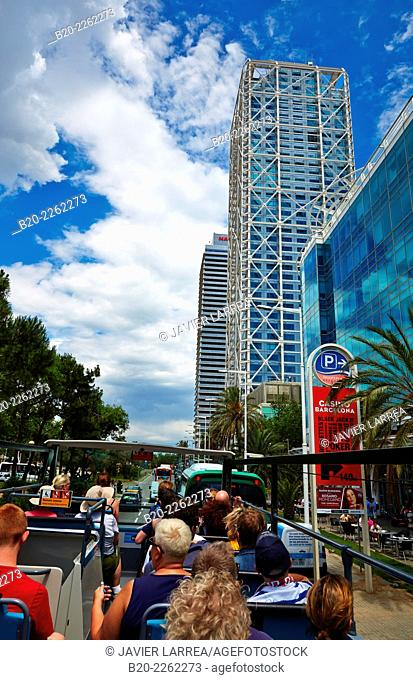 Tourist Bus. Mapfre tower and Hotel Arts. Port Olimpic. Barcelona. Catalonia. Spain