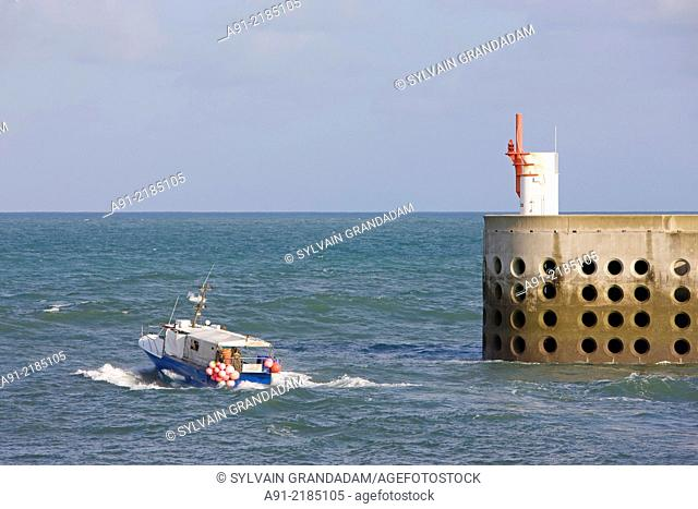 France, Normandy, Cotentin, La Hague district, Dielette Harbour and marina, the dike and buoy, fishing boat