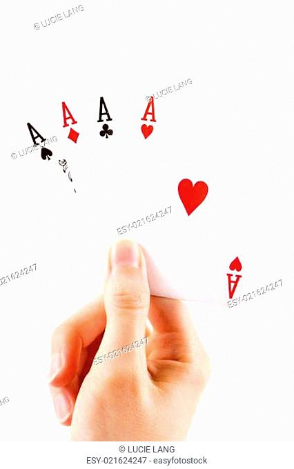 Aces being held over white
