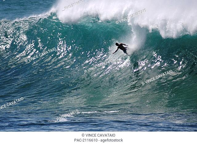 Hawaii, Waimea Bay, Man Surfing A Large Wave
