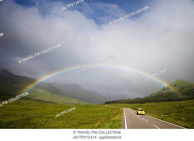 Scotland, Highland Region, Empty Road and Rainbow