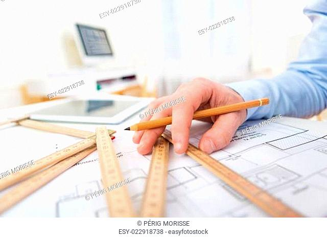 Close up view of an architect working at office