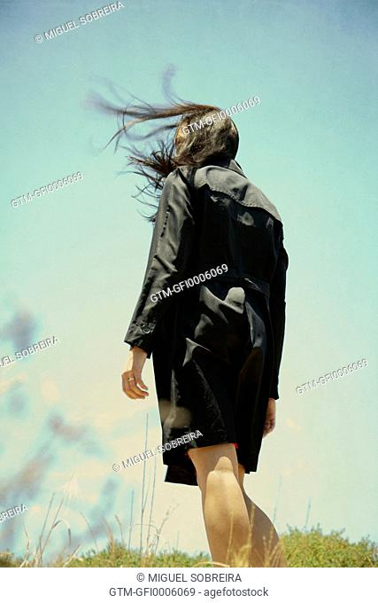 Windy Woman in Black Coat