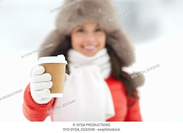 happy woman with coffee cup in winter