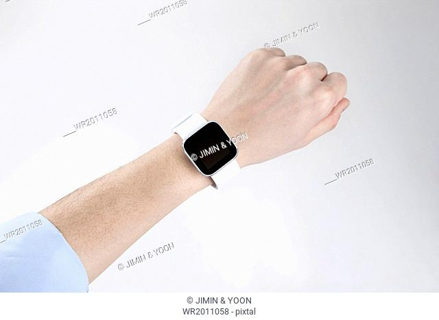 a person using his watch