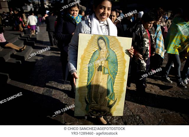 A pilgrim carries an image of the Our Lady of Guadalupe outside of the Our Lady of Guadalupe Basilica in Mexico City, December 4