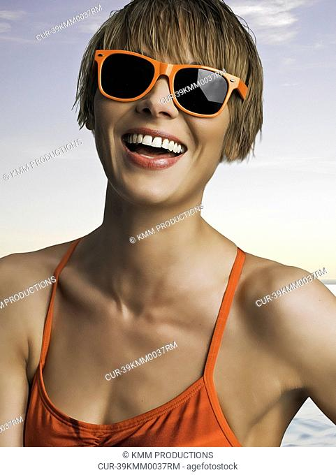 Laughing woman wearing sunglasses