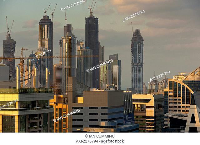 Office and residential tower blocks at dusk; Dubai, United Arab Emirates