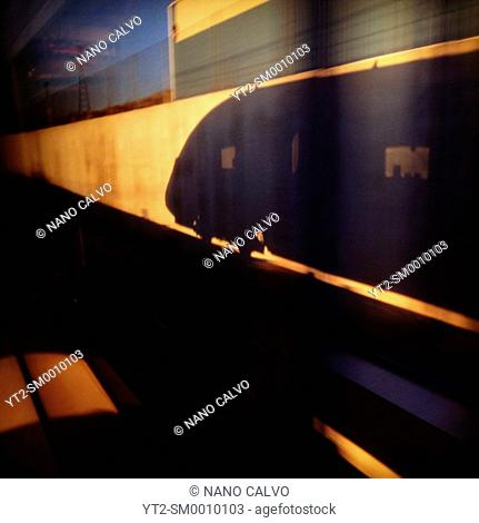 Silhouette of AVE high speed train reflected on wall