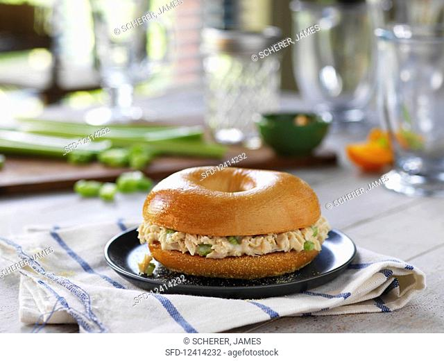 A bagel filled with tuna salad