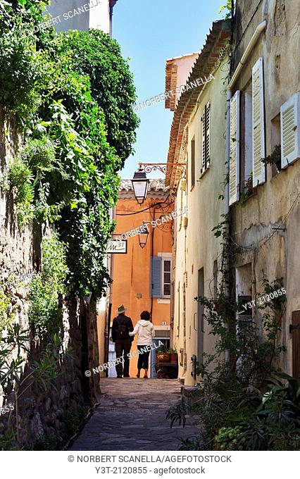 Europe, France, Var. Ramatuelle. Couple walking in a typical alley in the village