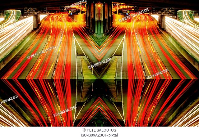 Abstract cityscape, mirror image of highway traffic light trails at night, Los Angeles, California, USA