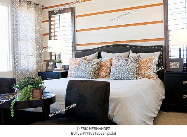 Pillows arranged on master bed; Valencia; California; USA