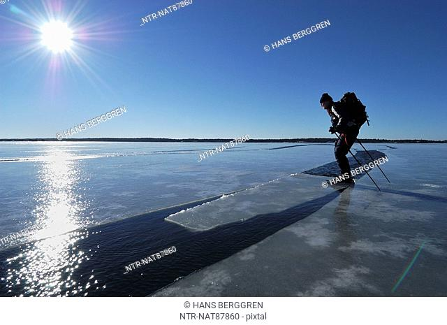 A man ice skating on melting ice