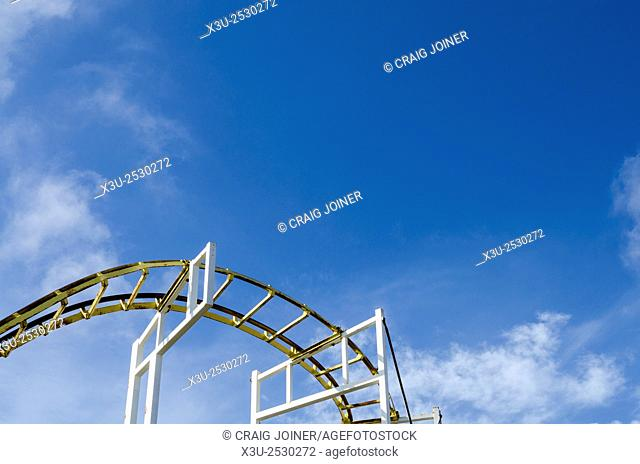 A roller coaster against a blue sky. Brighton Peir, East Sussex, England