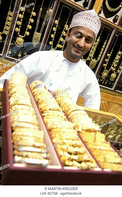 Young salesman with gold jewelry, Souk, Muscat, Oman, Middle East, Asia