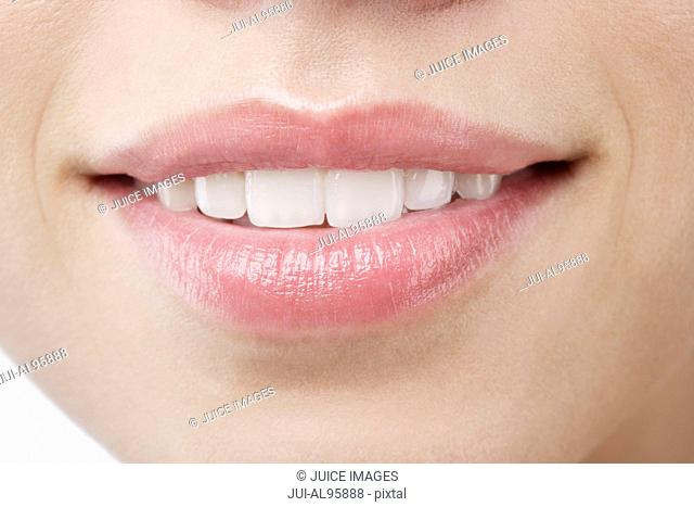 Close-up of young woman's lips
