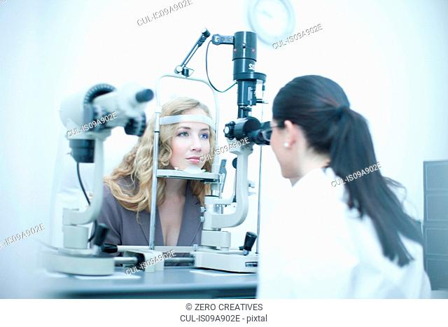 Patient and optician in eye clinic