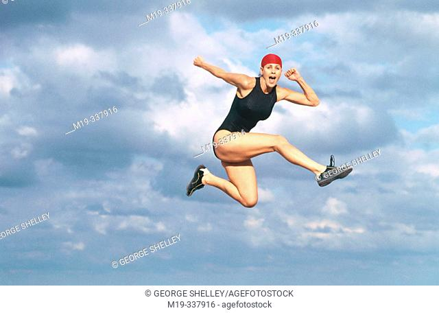 woman leaping-soaring in the sky