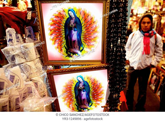 Souvenirs hang for sale outside the Basilica of Guadalupe in Mexico City. Hundreds of thousands of Mexican pilgrims converged on the Basilica
