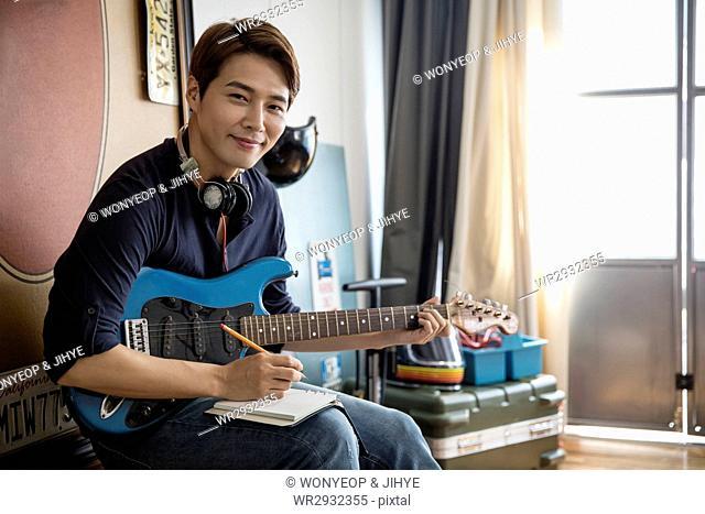 Smiling electric guitarist