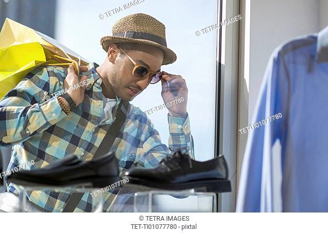 Stylish man window shopping