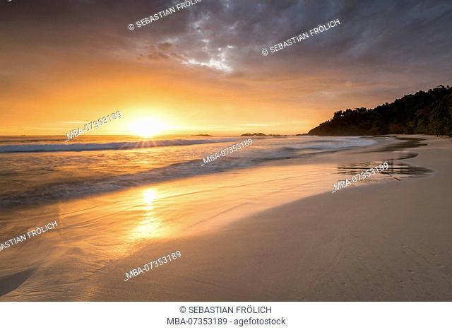 Sunset at the sand beach on the turtle island Bangkaru, Indonesia