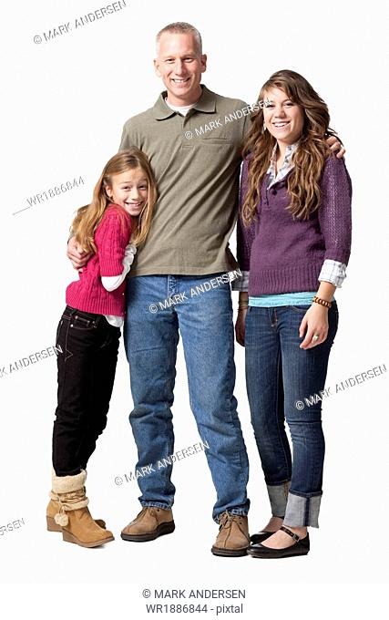 Studio shot of father with two daughters standing