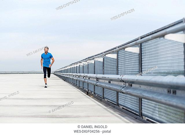 Man running on a parking level