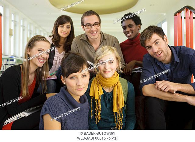 Germany, Leipzig, Group of university students sitting together, smiling, portrait