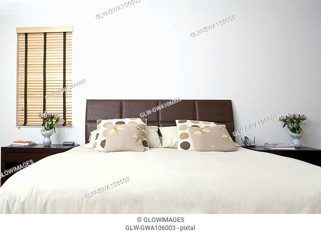 Bed and side tables in a bedroom