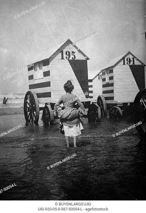 Bathing Booths at Ostend, Belgium, womanbather lifts up her dress 1912