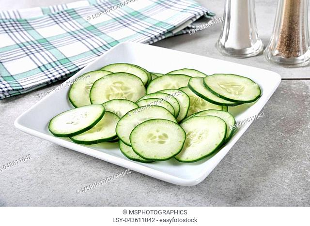 A plate of thin sliced cucumbers