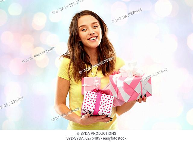 young woman or teenage girl with birthday gifts