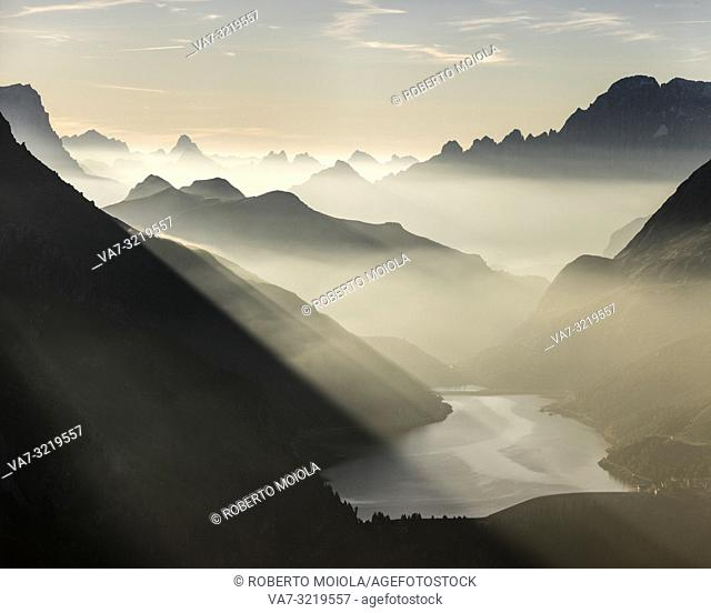 Panorama of Fedaia Pass and Dolomites peaks shrouded by mist Cima Belvedere Val di Fassa Trentino Alto Adige Italy Europe