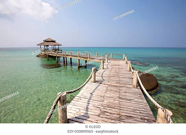 Wooden pier on the beautiful tropical beach in island Koh Kood , Thailand
