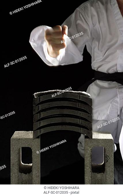 Blackbelt Preparing to Break a Stack of Concrete Blocks