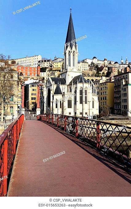 view of Lyon with red footbridge