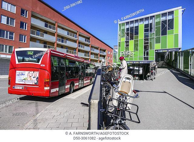 STOCKHOLM, SWEDEN Älvsjö or Alvsjo suburb. passengers at bus stop and commuter rail station