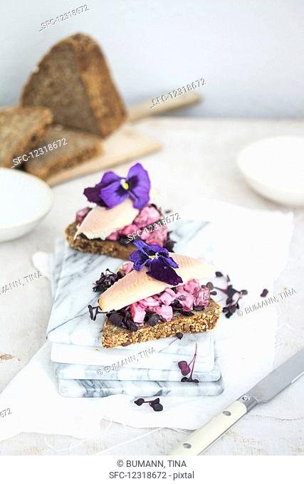 Danish Smörrebröd with beetroot salad and smoked trout