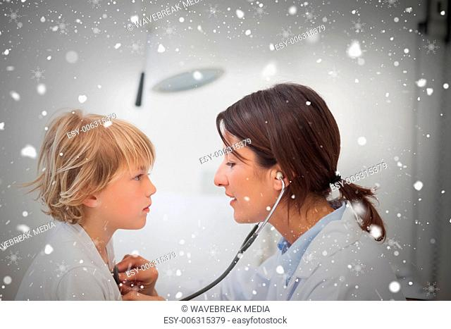 Composite image of doctor auscultating a child with a stethoscope