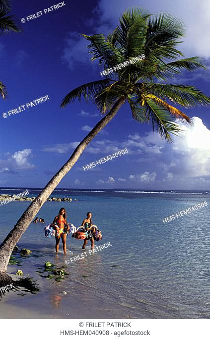 France, Guadeloupe (French West Indies), Sainte Anne, selling T-shirts and hats on the beach